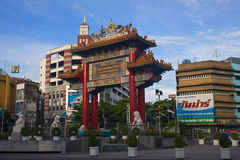 Gate of Chinatown. BANGKOK - AUGUST 23: Gate of Chinatown on August 23, 2012 in Bangkok, Thailand. Arch marks the beginning of famous Yaowarat Road, heart of Stock Photos