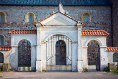 Gate of the Collegiate church in Tum Royalty Free Stock Images