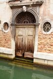 Gate damaged by the Venetian waters, Venice, Italy Royalty Free Stock Images