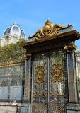 Gate decorated with golden metal in Paris in France. Huge gate decorated with golden metal in Paris in France stock images