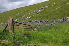 Gate in a dry stone wall in Derbyshire England. Gate in a dry stone wall in the Peak Districk National Park, England Stock Photo