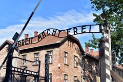 Auschwitz Concentration Camp. Gate entrance to concentration camp Auschwitz with a sign Arbeit Macht Frei in Oswiecim, Poland Stock Photo