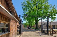 Gate entrance to concentration camp in Oswiecim, Poland. OSWIECIM, POLAND - MAY 12, 2016: Gate entrance to concentration camp Auschwitz with a sign Arbeit Macht Stock Photography