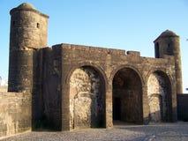 Gate in Essaouira's Harbor, Morocco. Gate of 16th century portughese fort in Essaouira Stock Photos