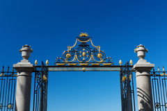 The gate and fence on a blue sky background Stock Image