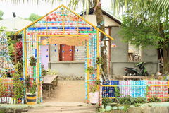 Gate and fence made from plastic bottles Stock Photos