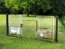 Gate in a field Royalty Free Stock Photo