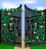 Gate and flowers. Old gates, overgrown with pink roses, green leaves Stock Photography