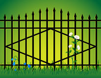 Gate and flowers. Stock Photo