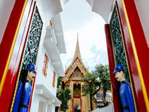 Gate framing with two guards statue at Wat Ratchabopit Royalty Free Stock Photo