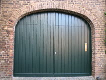 Gate from a garage. Green gate from a garage Stock Photography