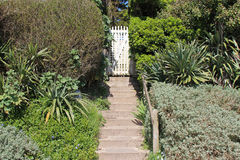 The gate of a garden in La Bernerie-en-Retz, France, was painted in white Royalty Free Stock Photo