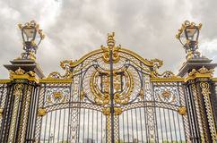 Gate with gilded ornaments in Buckingham Palace, London Royalty Free Stock Photo