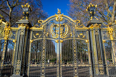 Gate with gilded ornaments in Buckingham Palace, London, UK Stock Photo