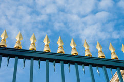 Gate with golden spikes Royalty Free Stock Image