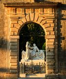 The gate of the Groblje Hrvatskih branitelja cemetery illuminated by setting Sun. stock photography