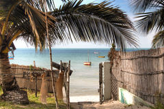 Gate of a guest house in Vilanculos with sea view. Gate of a guest house in Vilanculos in Mozambique which points to the beach and the Indian Ocean Stock Image