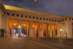 The gate into Heldenplatz (Heroes Square), at night - landmark attraction in Vienna, Austria Stock Image