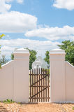 Gate and historic slave bell Stock Photo
