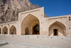 Gate of the historical stone caravanserai in the mountains of Middle East Royalty Free Stock Image