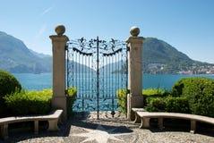 Gate at Lake Lugano, Switzerland. Patio leading to gate overlooking Lake Lugano, Switzerland on sunny day stock image
