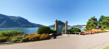 Gate at lake of Villa Ciani Stock Photo
