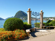 Gate at lake of Villa Ciani Stock Photos
