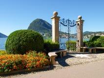Gate at lake of Villa Ciani Royalty Free Stock Image