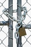 Gate Locked with chain and padlock Stock Photo