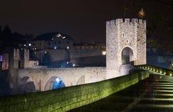 Gate in medieval european town in night. Besalu Royalty Free Stock Photo