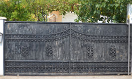 Gate. Modern metal gate of the private house in the garden Stock Photo