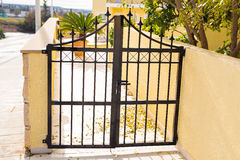 A gate of a modern village courtyard. Real estate related. Royalty Free Stock Images