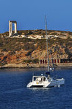 The gate of the Naxos temple. Yacht on front of the gate and the Naxos temple, Greece Royalty Free Stock Photo