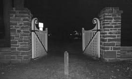 Gate. An old fashion white open gate Royalty Free Stock Photos