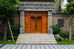 Gate of old-fashioned Chinese building by slopy street Stock Photo