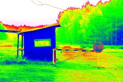 Gate and old gate house at small parking place at forest. Technical house and countryside in thermography scan. Stock Photos