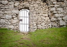 Gate in old stone castle wall, architectural detail Royalty Free Stock Images