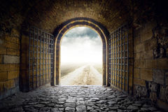 Free Gate Opening To Endless Road Leading Nowhere Stock Photo - 43892210