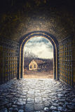Gate opening to road leading to an old abandoned house Stock Image
