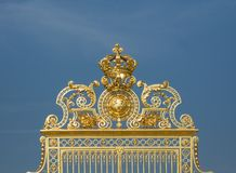 Gate ornaments. Gilded ornaments of the gate of Versailles palace, France Royalty Free Stock Photos