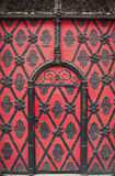 Gate with ornaments. Red historical gate with iron ornaments royalty free stock images