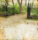 Gate into a Park on a Grunge Background Royalty Free Stock Photo