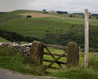 Gate & Post. Finger post (public footpath) and gate into a lush English upland field Royalty Free Stock Photo