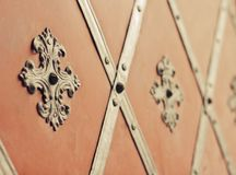 Gate with rivets and ancient style facing Royalty Free Stock Photography