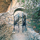 Gate in rock. The gate on the road to rock royalty free stock images
