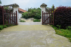 Gate of rural courtyard at roadside Stock Photo