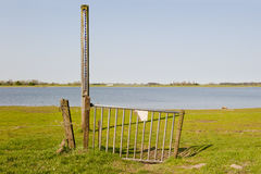 Gate with scale of waterlevel in floodplain of the Stock Photos