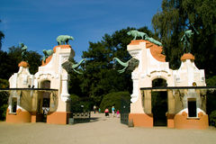 Gate with sculptures. Of people and animals Stock Photos