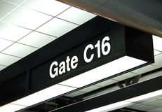 Gate sign at the airport. Information on a gate sign at the airport Stock Photos