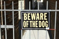 Beware of the Dog. A gate with a sign that reads Beware of the Dog royalty free stock image
